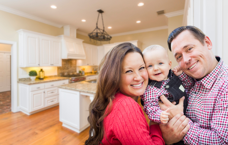 Young Happy Family Inside Beautiful Custom Kitchen.