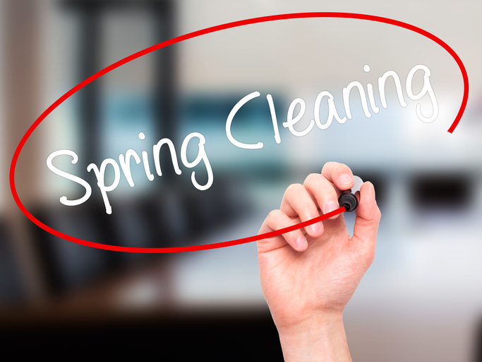 Man Hand writing Spring Cleaning with black marker on visual screen. Isolated on background. Business, technology, internet concept. Stock Photo