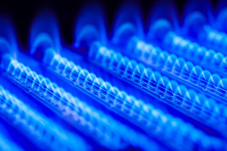 Propane flame inside of gas boiler furnace